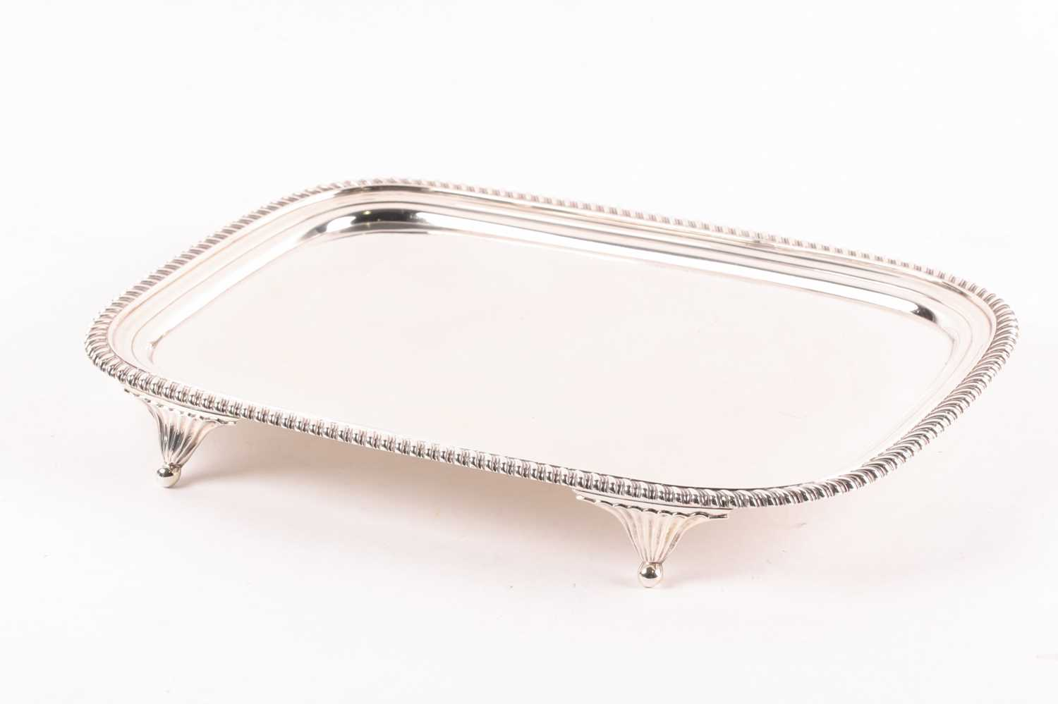A George III rectangular silver salver. London 1812 William Bennet, with raised gadrooned border