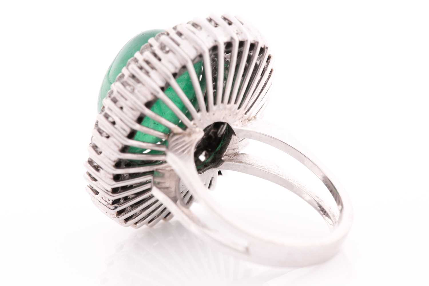 A diamond and emerald cocktail ring, circa 1960s, centred with an oval cabochon emerald, measuring - Image 4 of 6