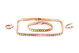An 18ct yellow gold and multi-gemstone rainbow necklace, bracelet, and matching earrings, the