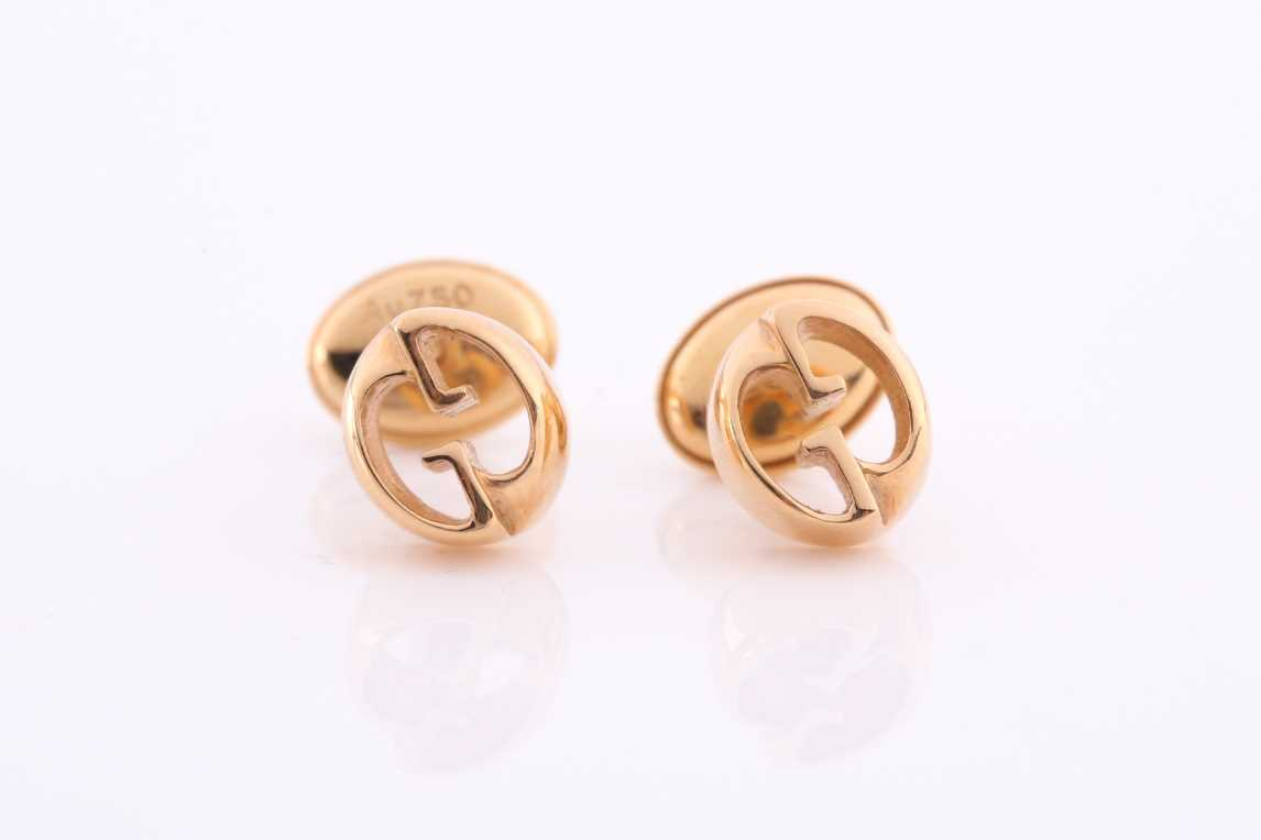 Gucci. A pair of 18ct yellow gold stud earrings of double G design, in original box and outer box. - Image 3 of 5