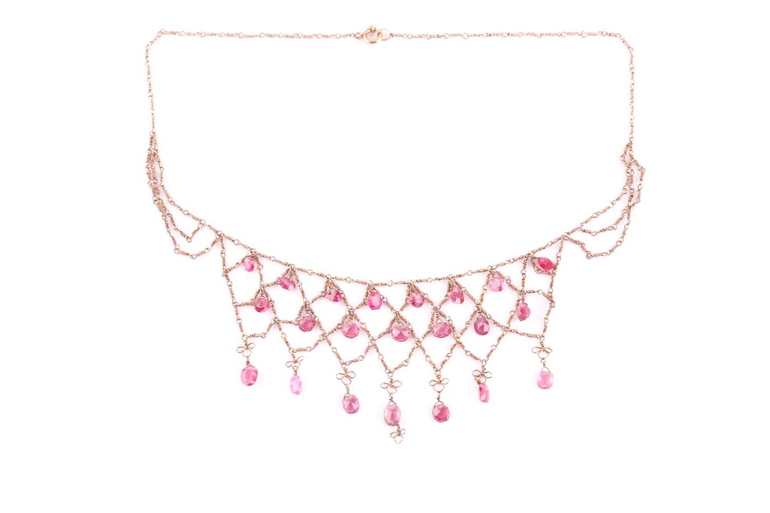 A yellow metal and pink spinel fringe necklace, suspended with faceted pink spinels, on twist-link