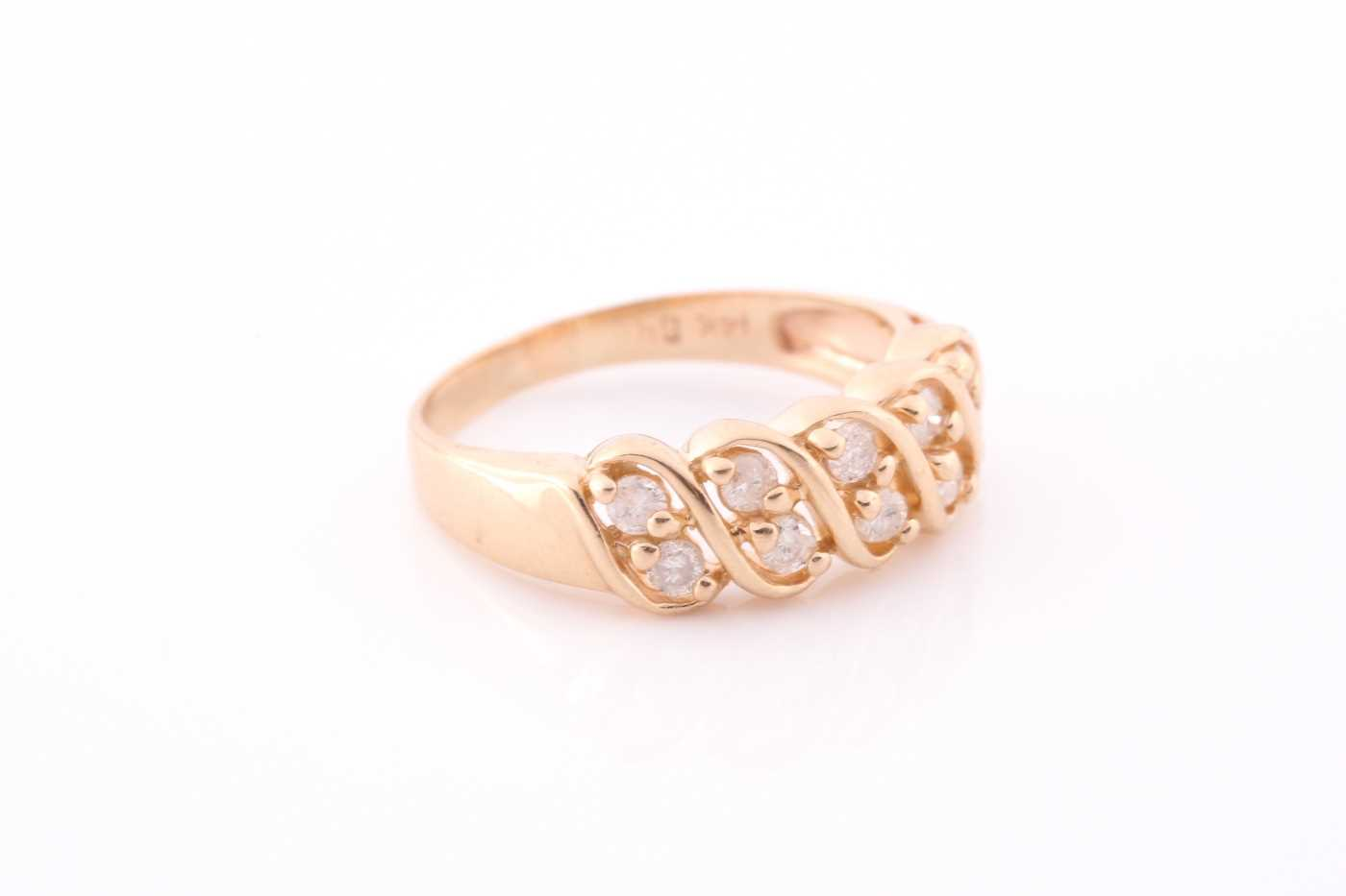 A yellow metal and diamond ring set with two rows of round-cut diamonds of approximately 0.50 carats - Image 4 of 4