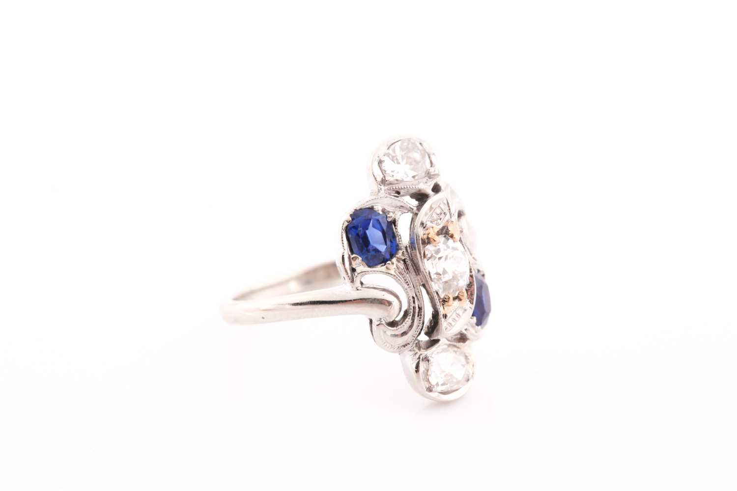 A diamond and sapphire ring, in the Art Nouveau style, the stylised mount inset with old Mine - Image 2 of 4