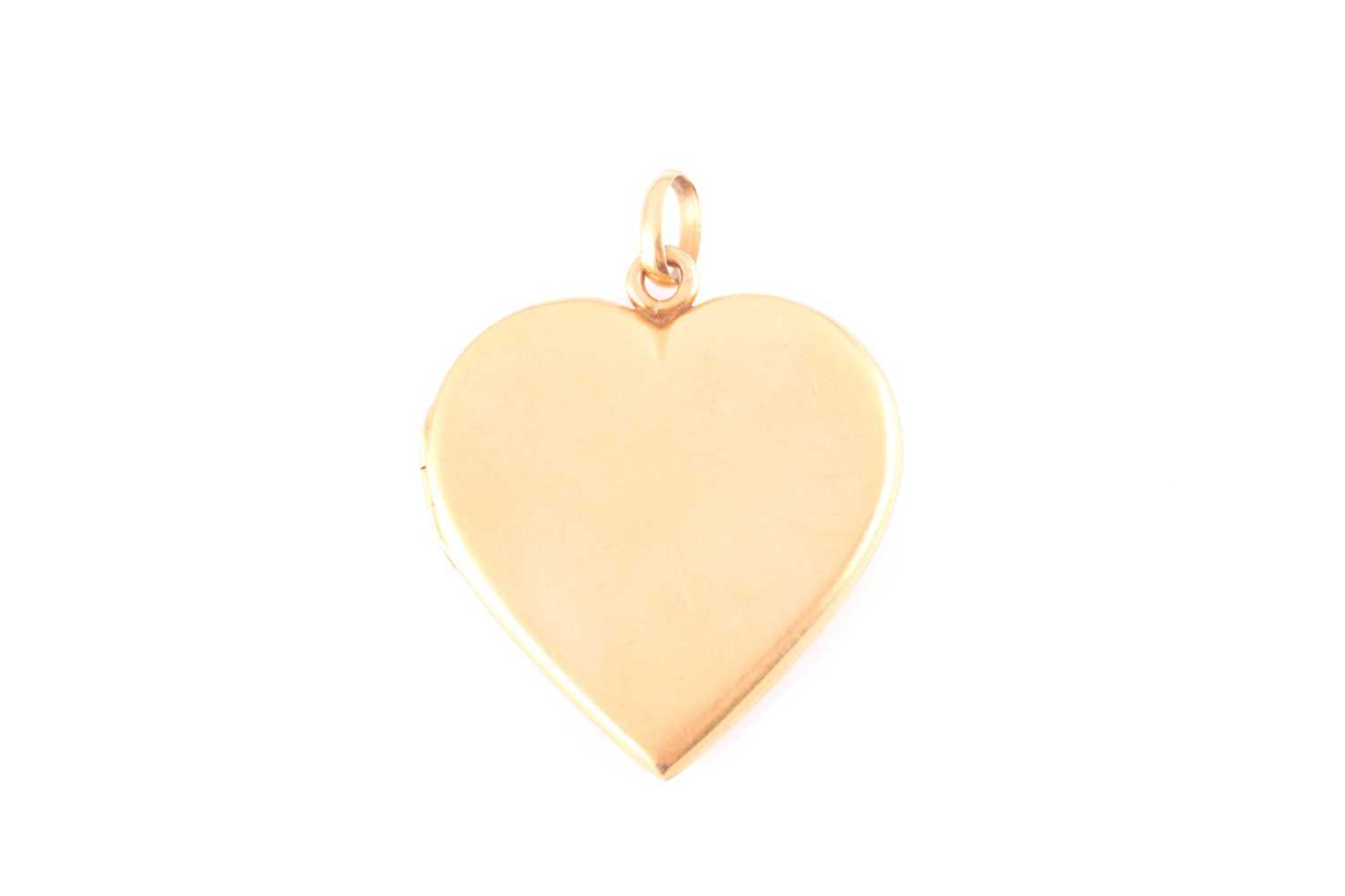 An early 20th century yellow metal heart-shaped locket pendant, the hinged front inset with small - Image 2 of 5