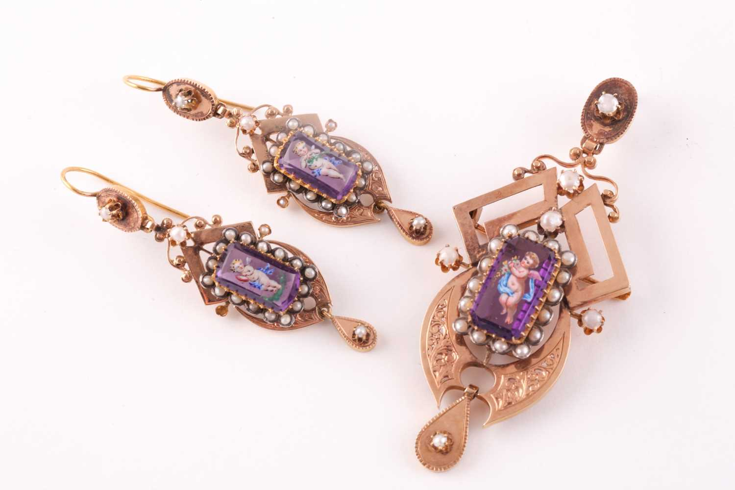 A late 19th century yellow gold French pendant, centred with amethyst glass, polychrome painted with