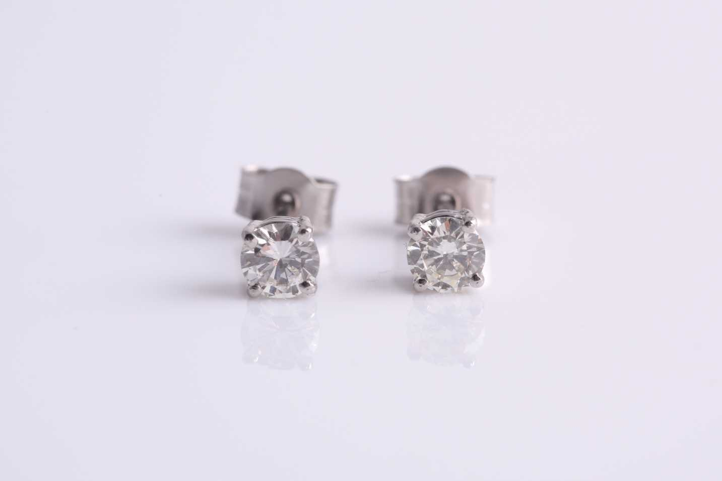 A pair of platinum and diamond ear studs, the round brilliant-cut diamonds of approximately 0.45