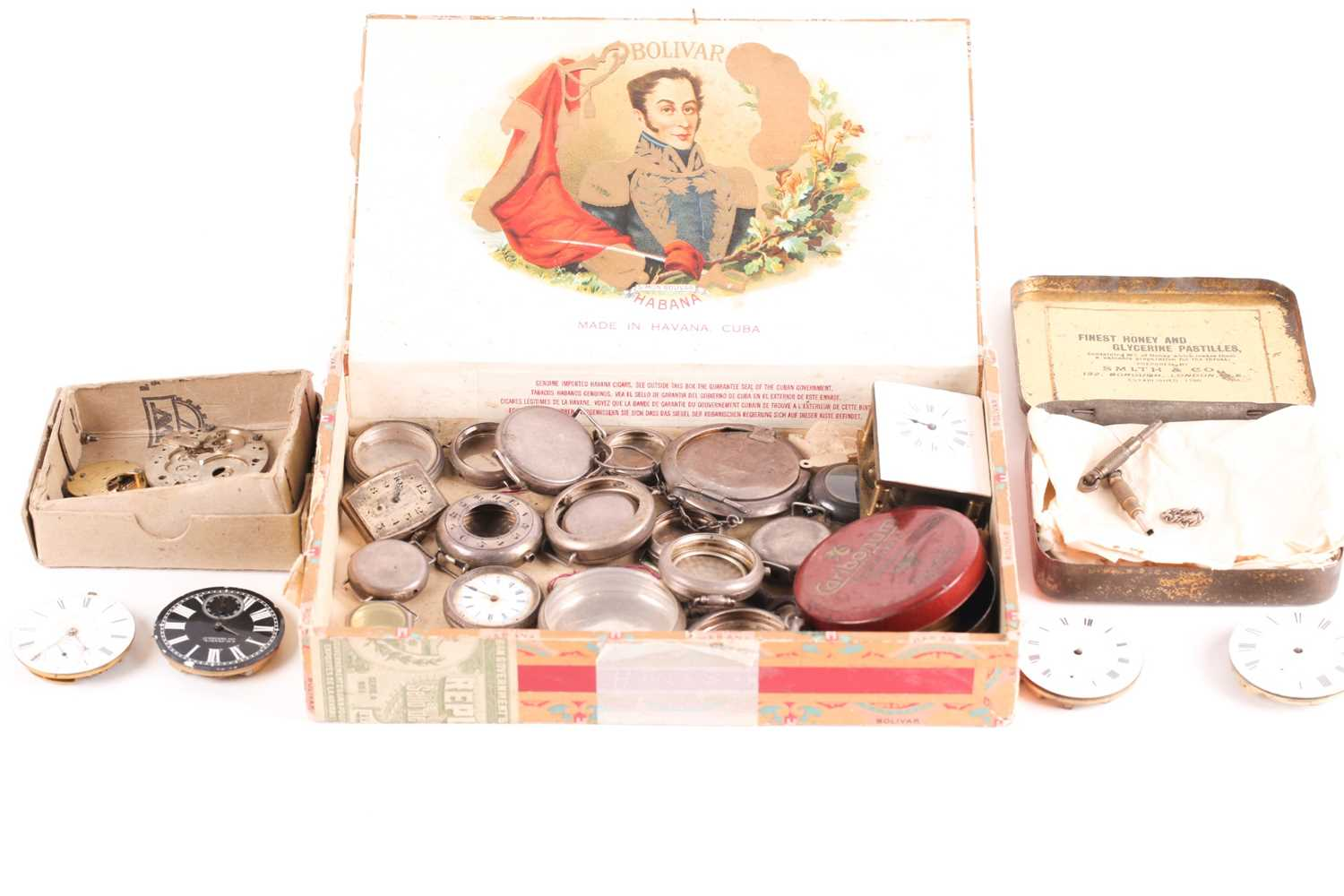 A quantity of watch and clock parts including a number of silver watch cases, several enamel dials