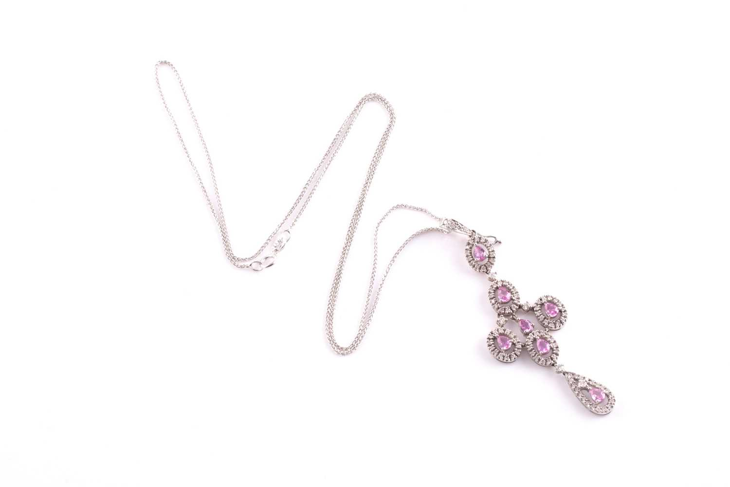 An 18ct white gold, diamond, and pink sapphire quatrefoil drop pendant necklace, the cross design - Image 4 of 4