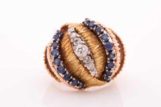 A vintage sapphire and diamond dress ring - circa 1960; comprising rows of circular cut sapphires