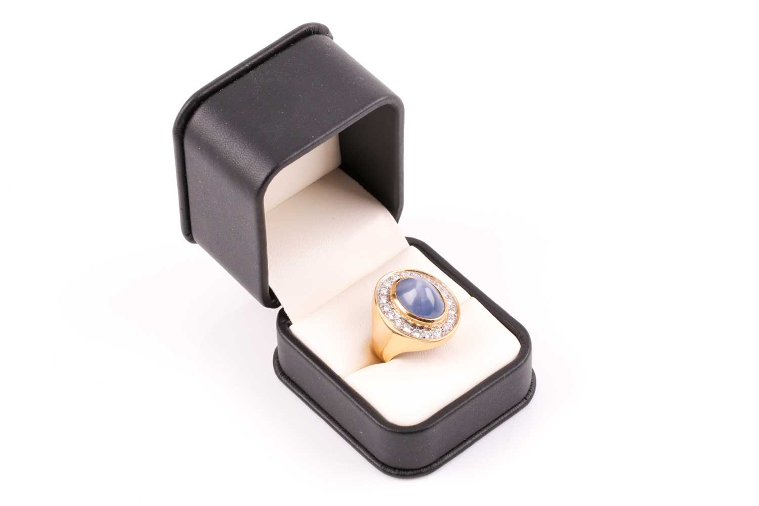 An 18ct yellow gold, diamond, and star sapphire cocktail ring, set with a domed cabochon sapphire, - Image 8 of 9