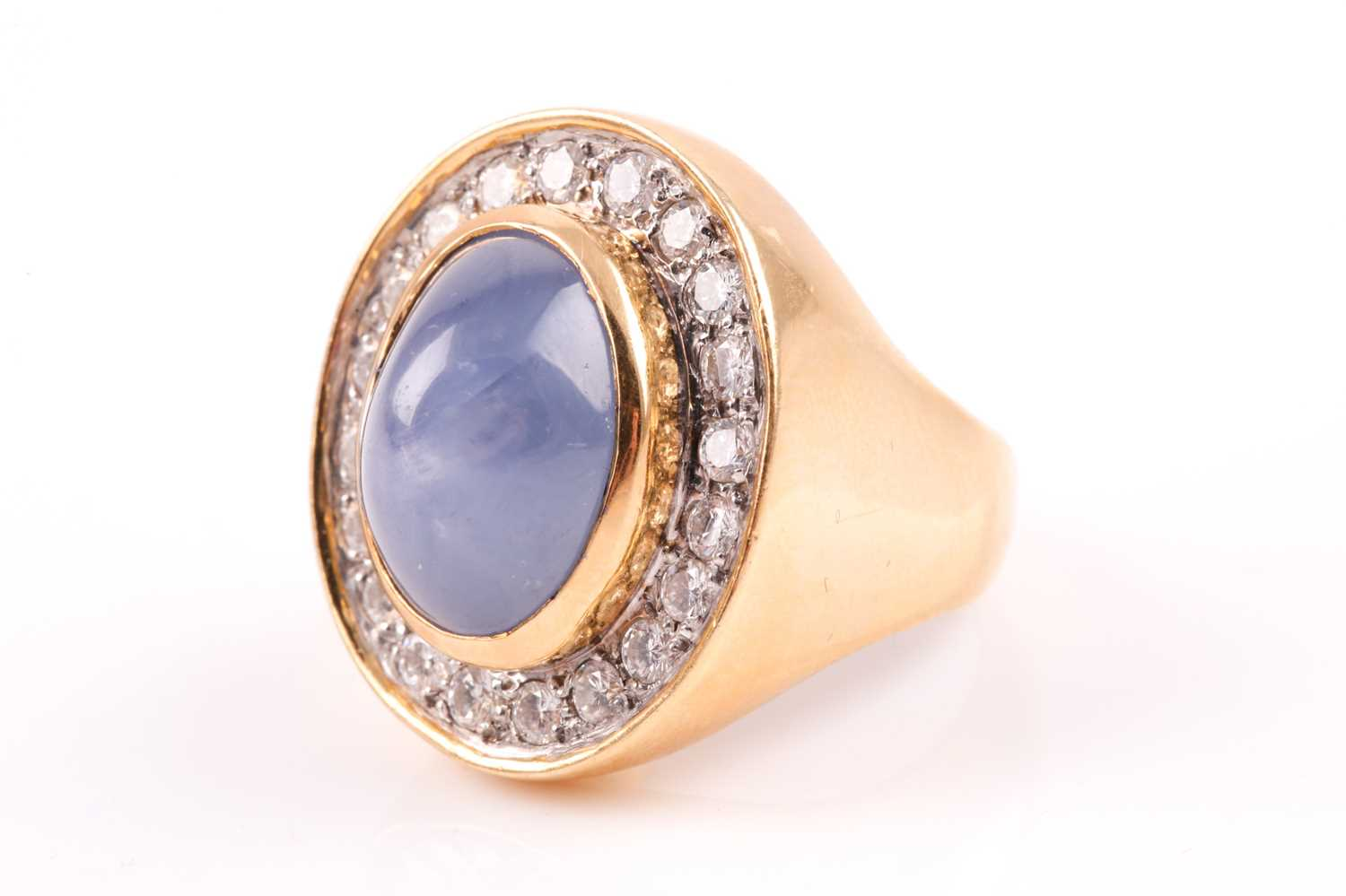 An 18ct yellow gold, diamond, and star sapphire cocktail ring, set with a domed cabochon sapphire, - Image 3 of 9