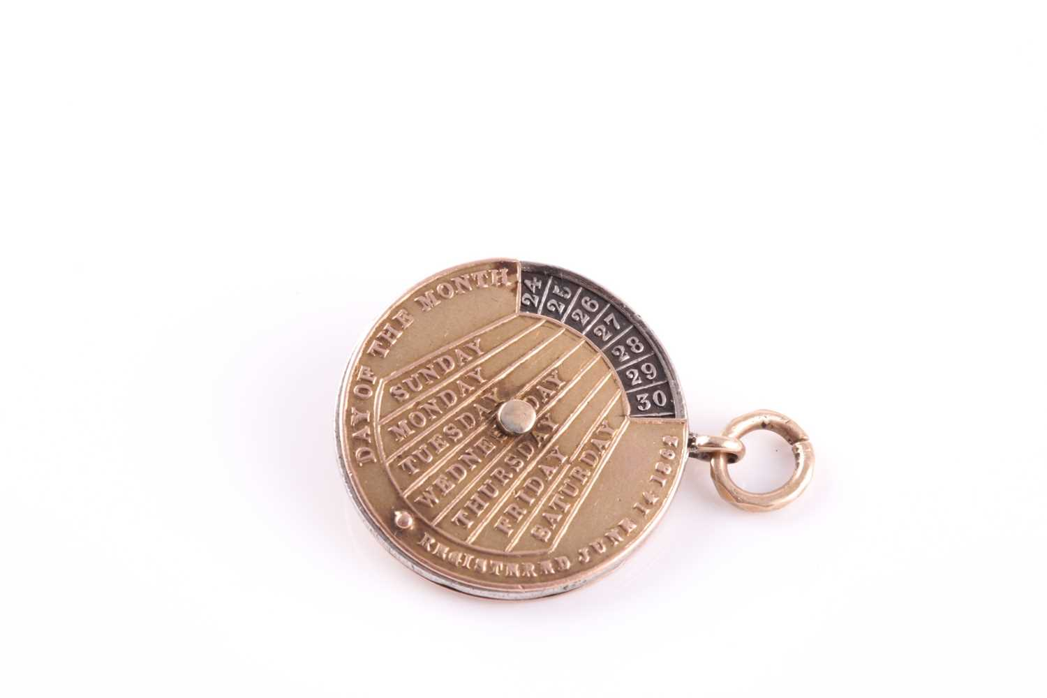 A 19th century yellow metal perpetual calendar pendant, with white metal central disk, featuring - Image 4 of 4