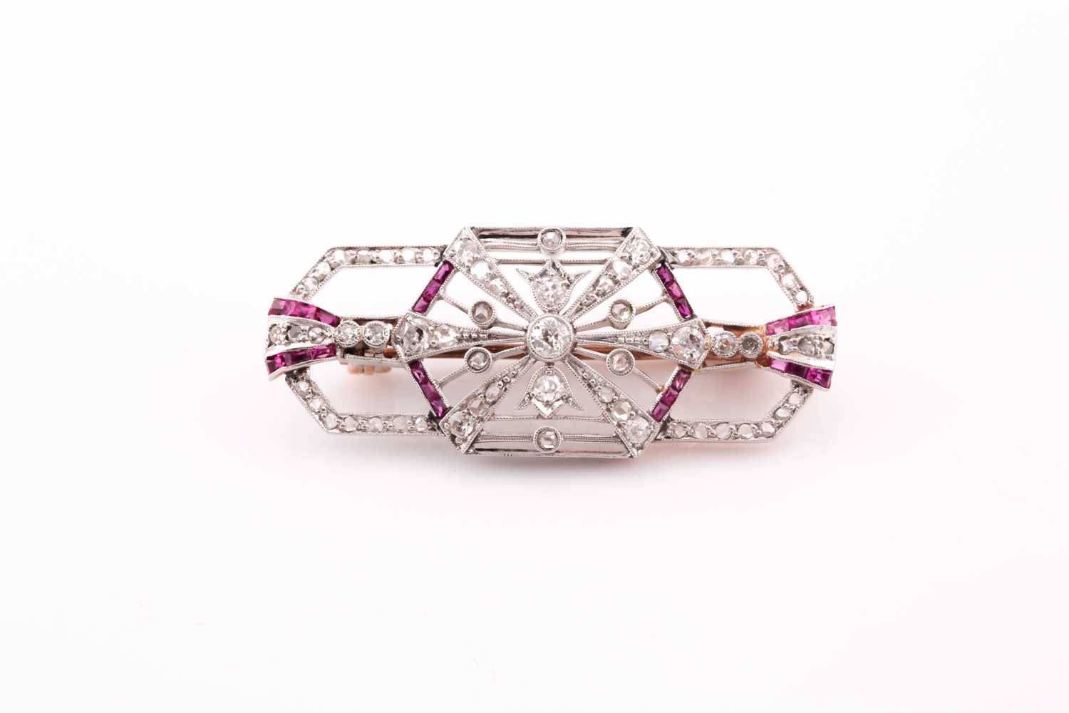 A diamond and ruby plaque brooch, in the Art Deco style, set with round single-cut and rose-cut