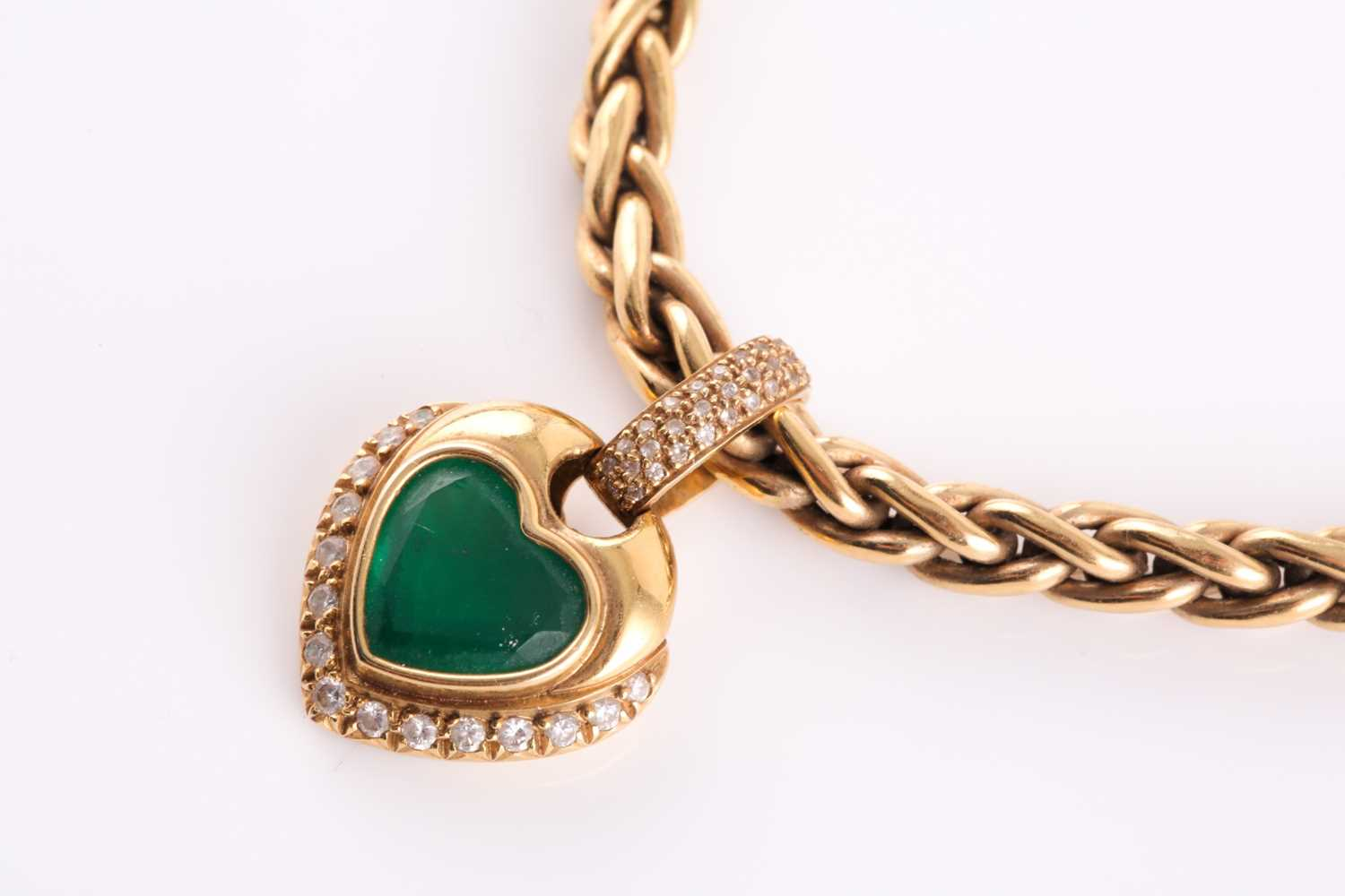 An 18ct yellow gold, diamond, and green stone heart-shaped pendant, with pave-set diamond suspension - Image 5 of 5