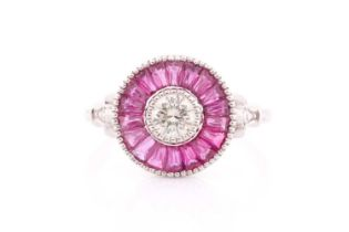 A diamond and ruby target ring, in the Art Deco style, centred with a round brilliant-cut diamond,