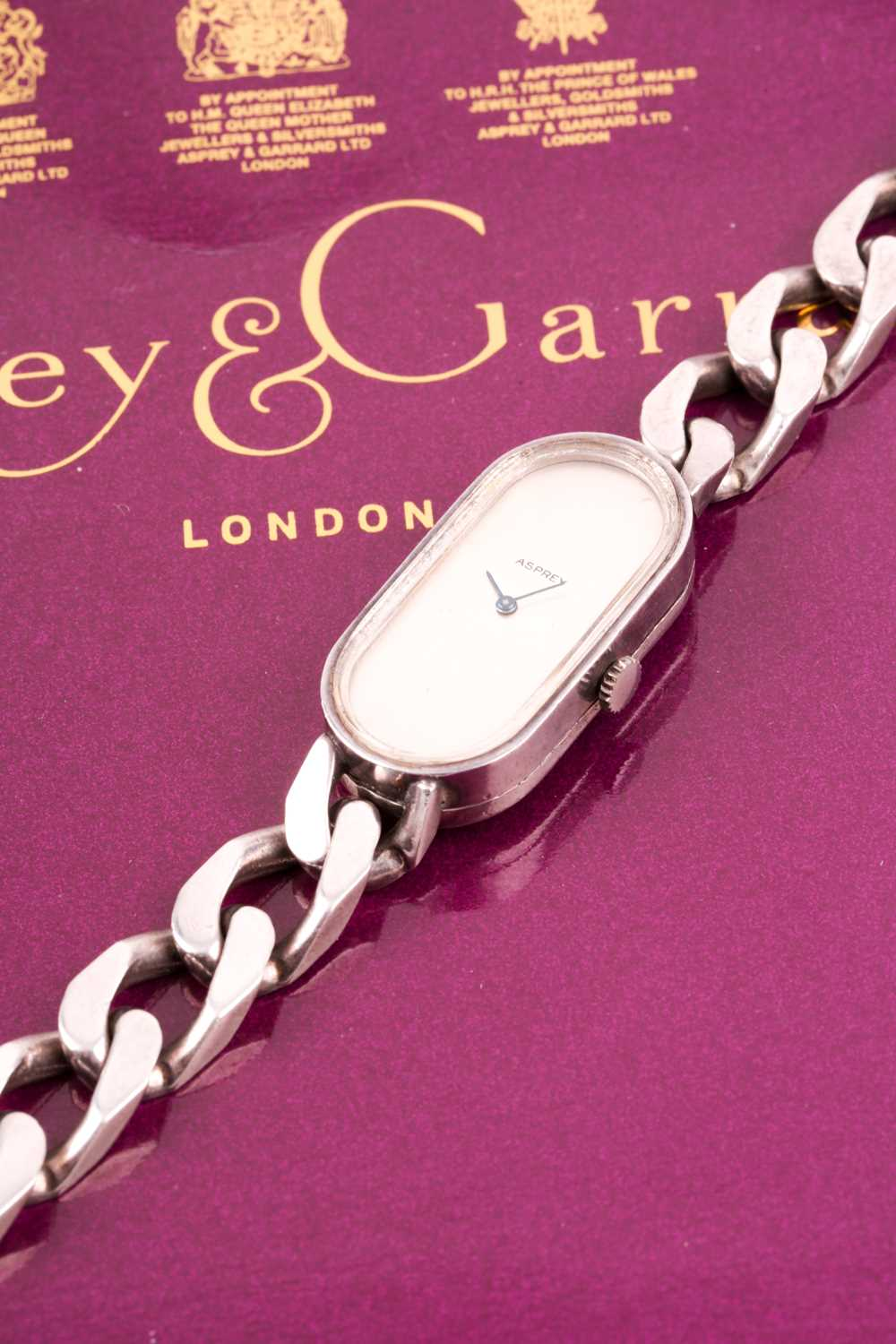 Asprey. A lady's silver wristwatch, the elongated oval brushed silvered dial with simple arrowhead - Image 12 of 18