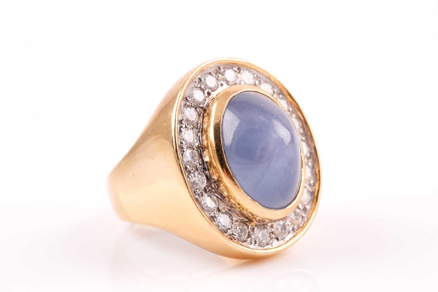 An 18ct yellow gold, diamond, and star sapphire cocktail ring, set with a domed cabochon sapphire, - Image 5 of 9