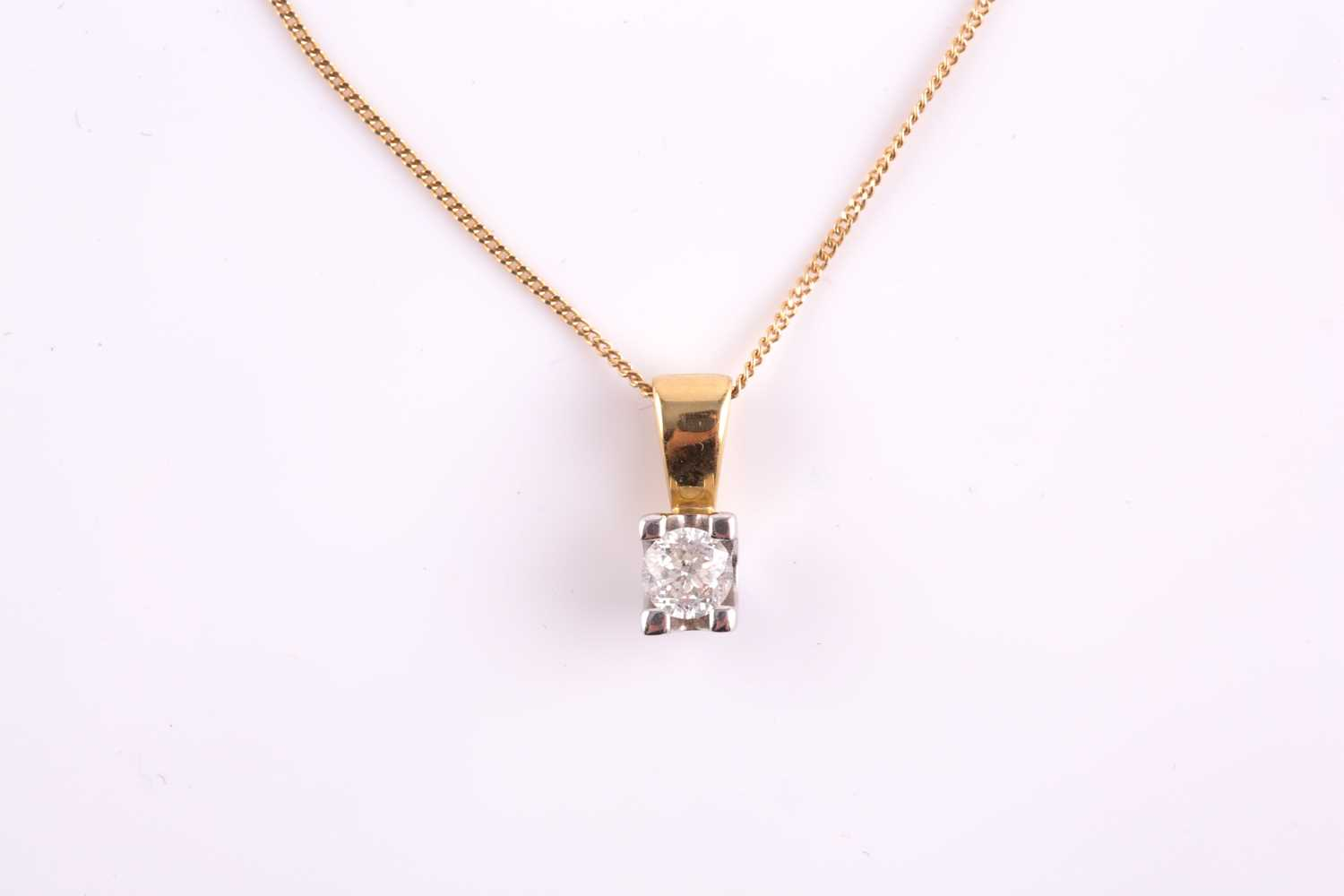 An 18ct yellow gold and solitaire diamond pendant, set with a round brilliant-cut stone of