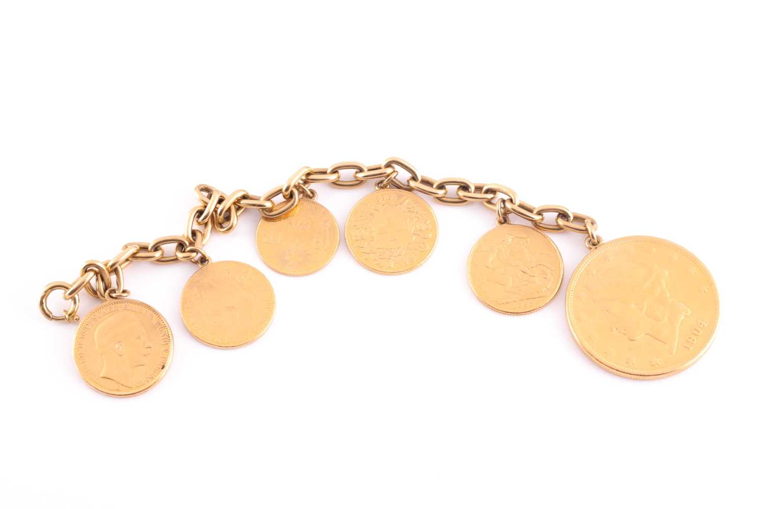 A yellow metal bracelet, suspended with six various fine gold coins, including an American 20 dollar - Image 2 of 3