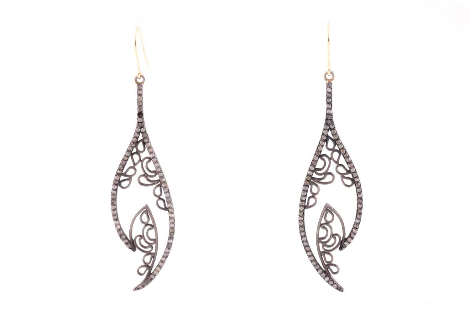 A pair of diamond drop earrings, the silvered openwork mounts inset with mixed old and rose-cut