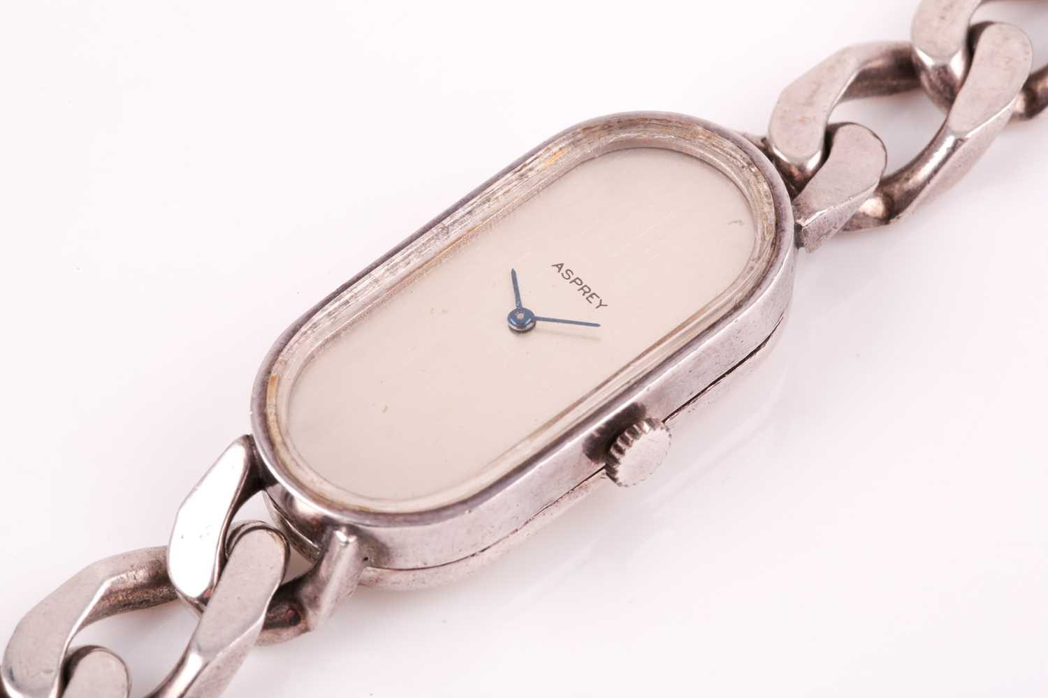 Asprey. A lady's silver wristwatch, the elongated oval brushed silvered dial with simple arrowhead - Image 18 of 18