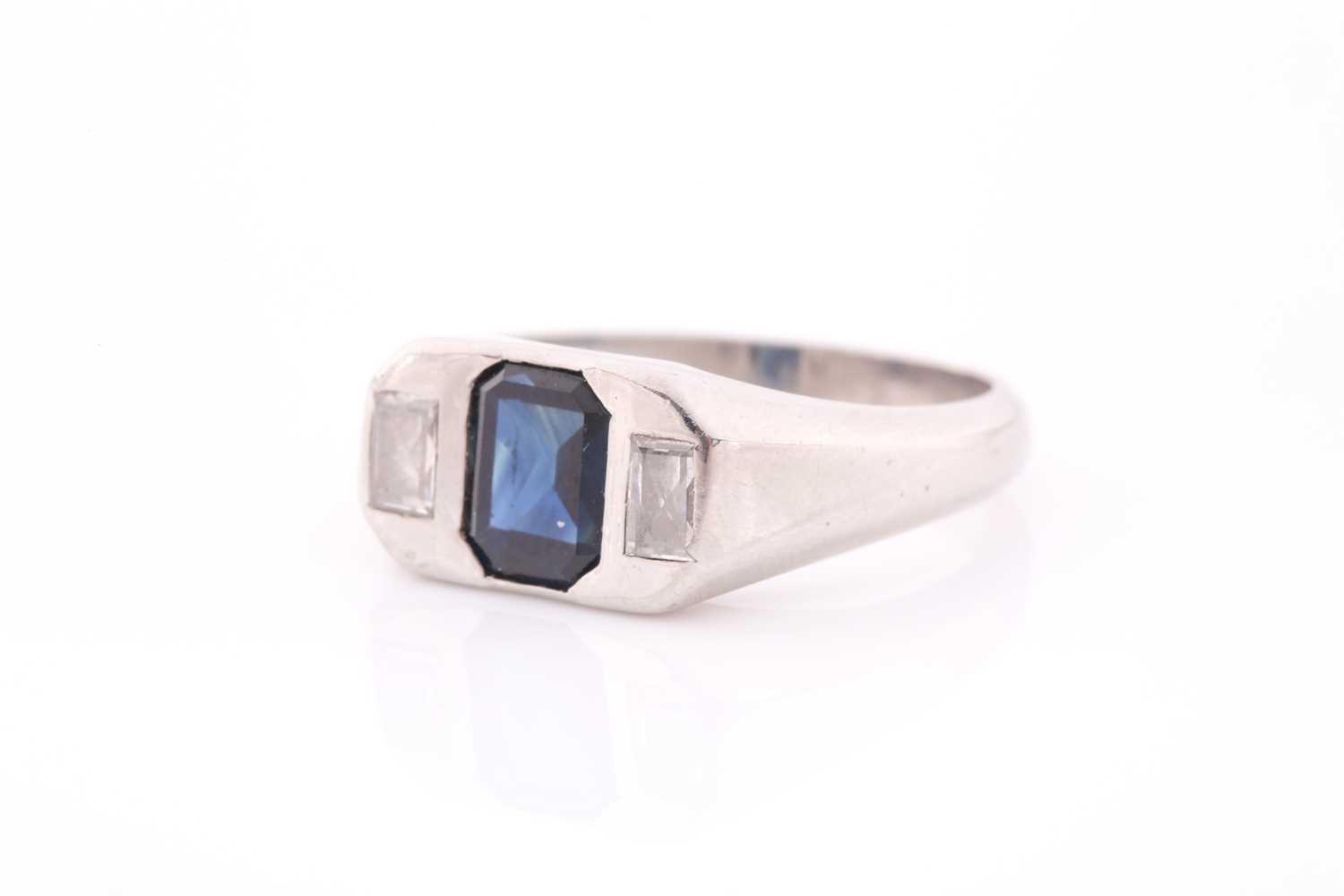 A diamond and sapphire ring, set with a mixed rectangular-cut sapphire, flanked with two modified - Image 4 of 4