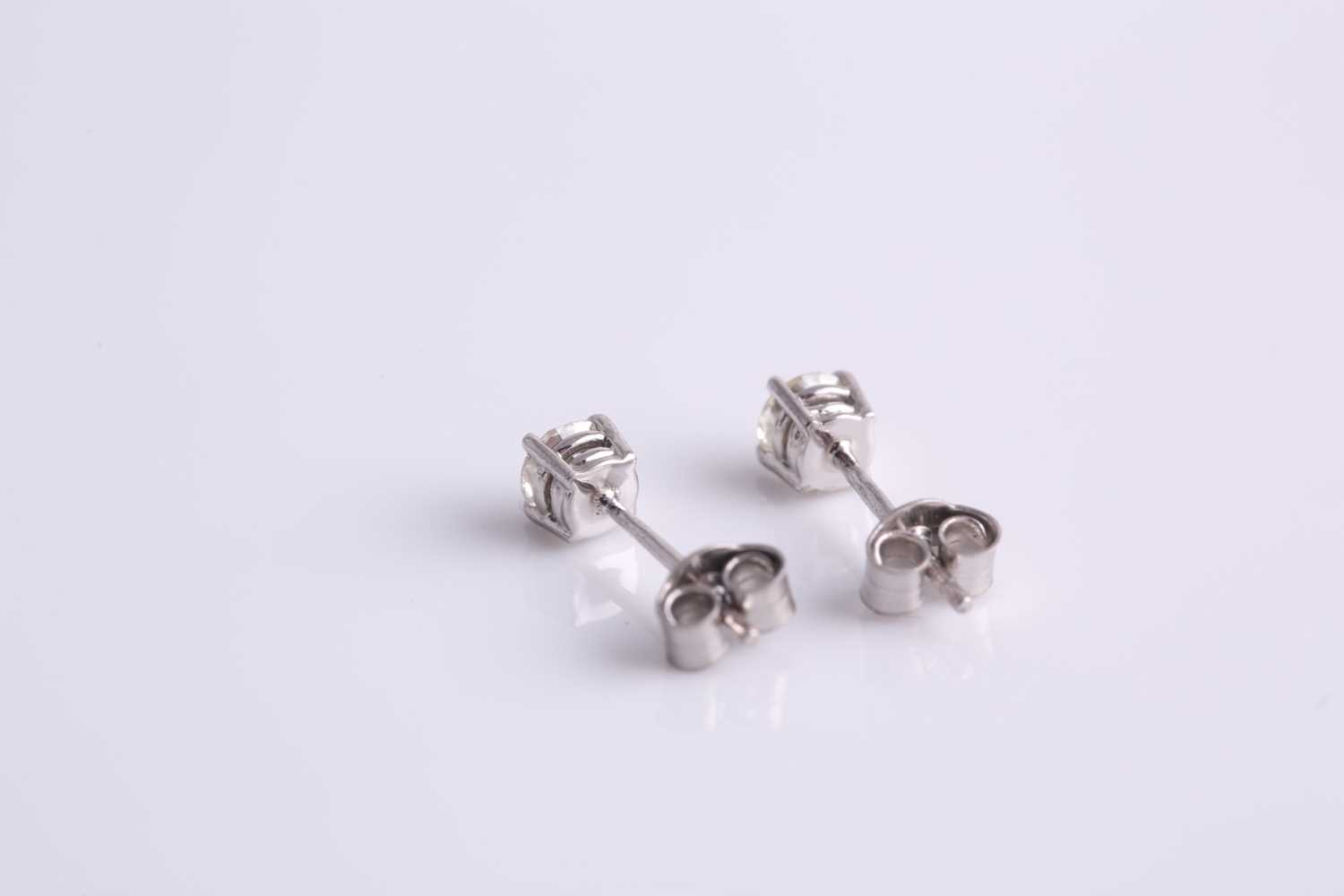 A pair of platinum and diamond ear studs, the round brilliant-cut diamonds of approximately 0.45 - Image 2 of 2
