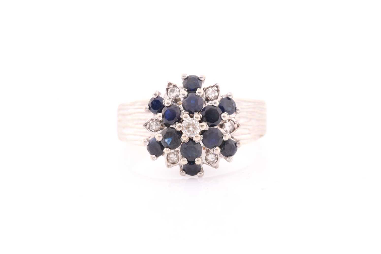 An 18ct white gold, diamond, and sapphire cluster ring, set with a cluster of round-cut sapphires