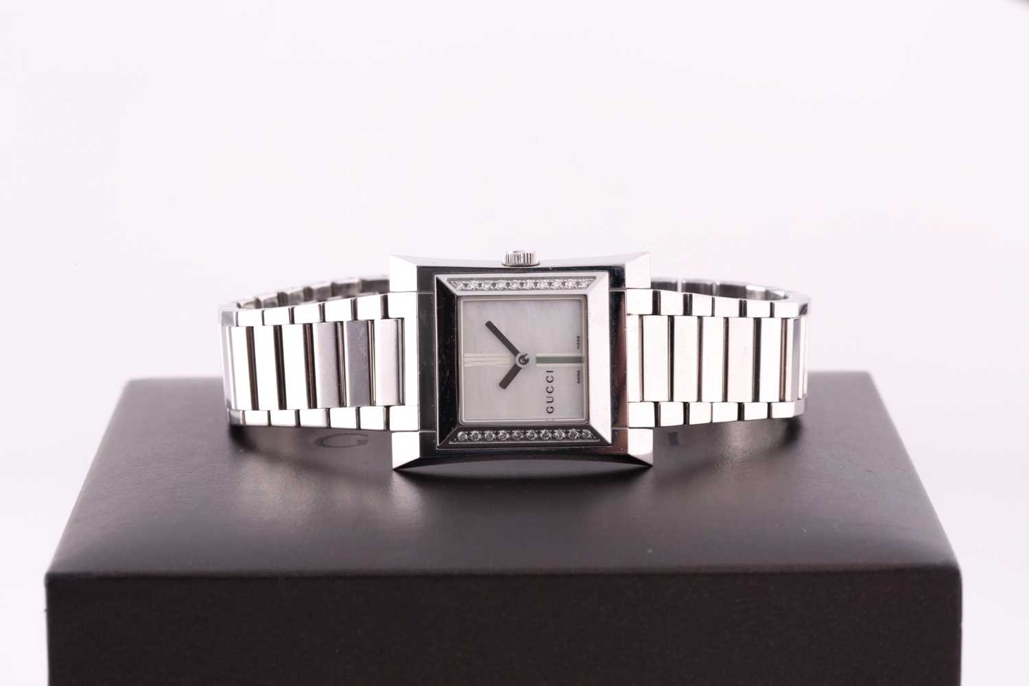 A ladies stainless steel watch by Gucci, with mother-of-pearl square dial, small diamonds set to - Image 4 of 10