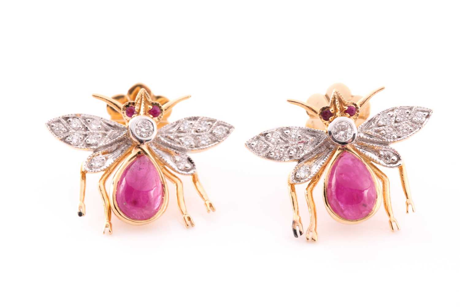 A pair of yellow metal, diamond, and ruby earrings in the form of bees, each bee with a diamond-