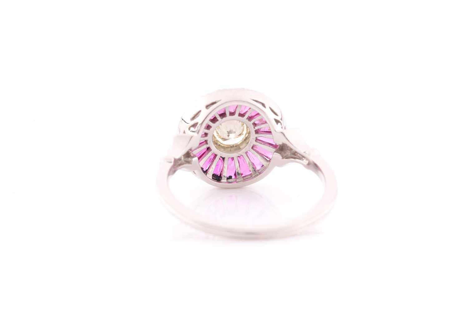 A diamond and ruby target ring, in the Art Deco style, centred with a round brilliant-cut diamond, - Image 4 of 4