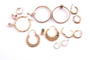 A pair of 9ct yellow gold hoop earrings, together with a pair of 9ct yellow gold and white paste