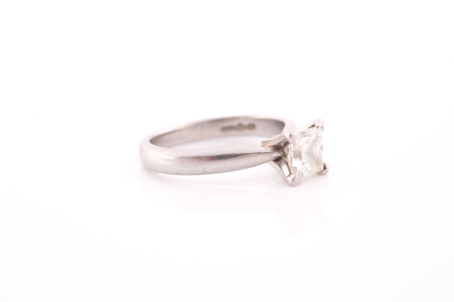 A platinum and diamond ring, set with a princess-cut diamond of approximately 0.80 carats, - Image 4 of 4