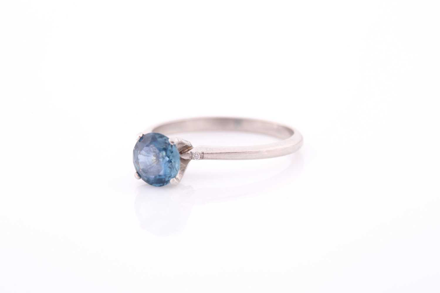 A platinum and solitaire sapphire ring, set with a mixed round-cut blue sapphire of approximately - Image 2 of 4