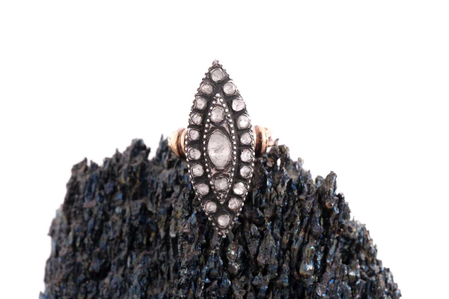 A rose-cut diamond ring, in the 19th century style, the silver marquise-shaped mount inset with