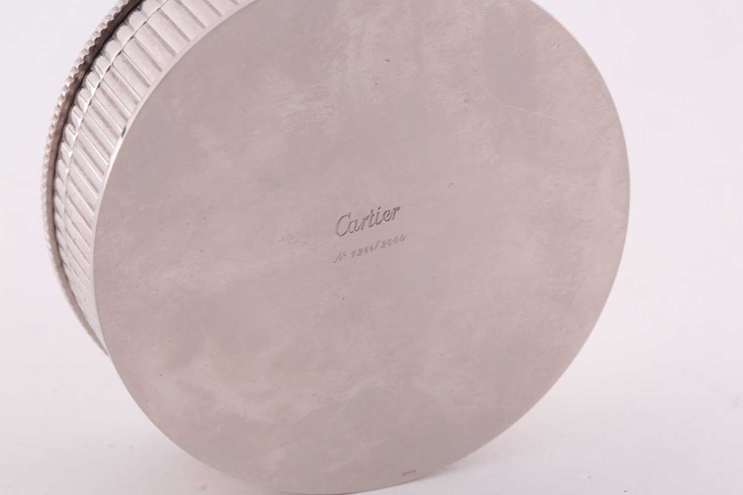 A Cartier chrome desk calender, with adjustable year, month, and date dial to lid, 8 cm diameter, - Image 5 of 5