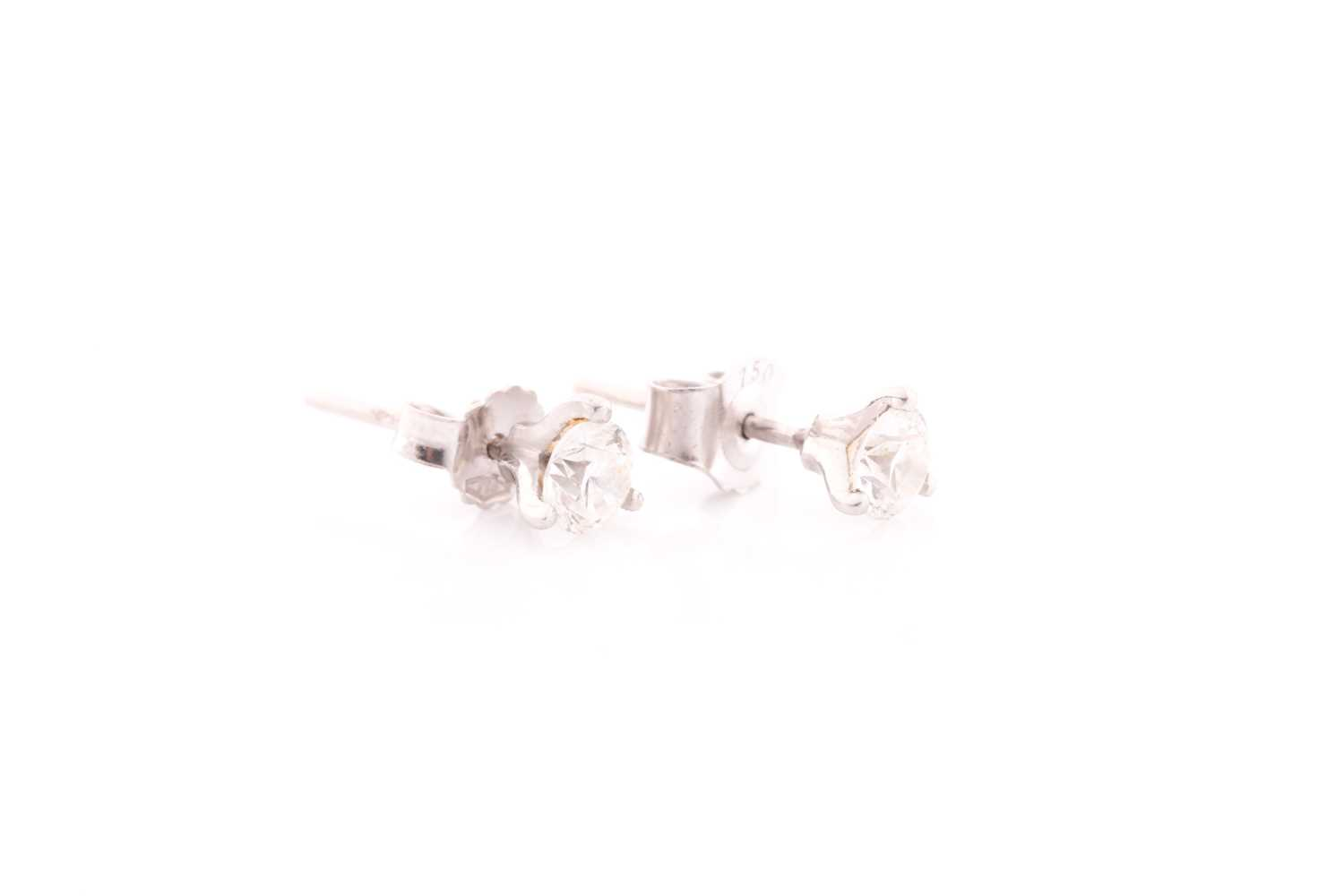 A pair of solitaire diamond stud earrings, set with round brilliant-cut diamonds of approximately - Image 2 of 3