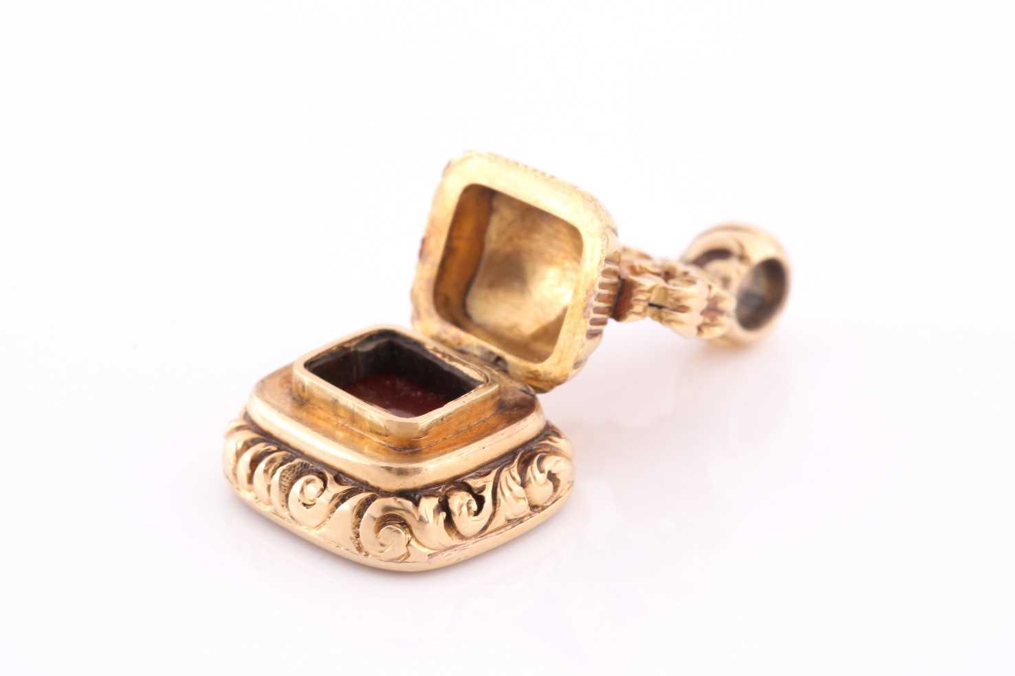A yellow metal and red agate fob seal, with concealed locket, hinged base, unmarked (tests as 15ct - Image 3 of 5