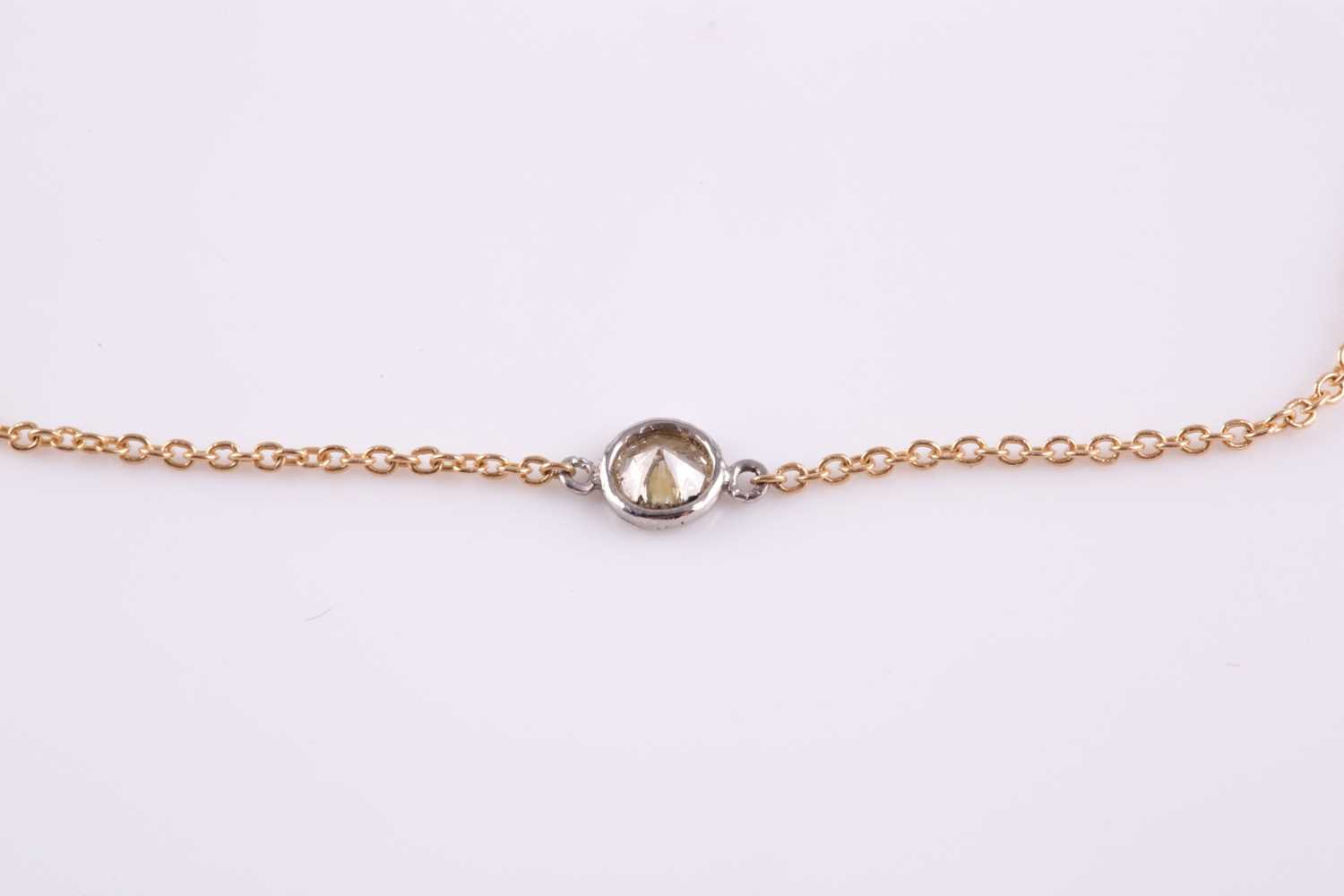 An 18ct yellow gold and diamond necklace, the chain set with a collet-mounted round brilliant-cut - Image 2 of 2