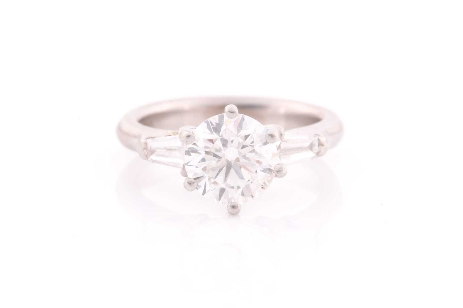 A platinum and diamond ring, set with a round brilliant-cut diamond of approximately 1.50 carats,