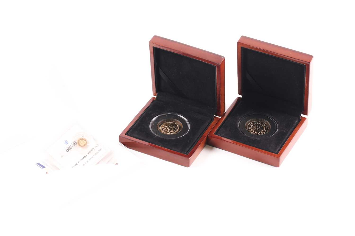 Two boxed 9ct gold proof Double Crowns, commemorating the birth of Prince George (2014) and