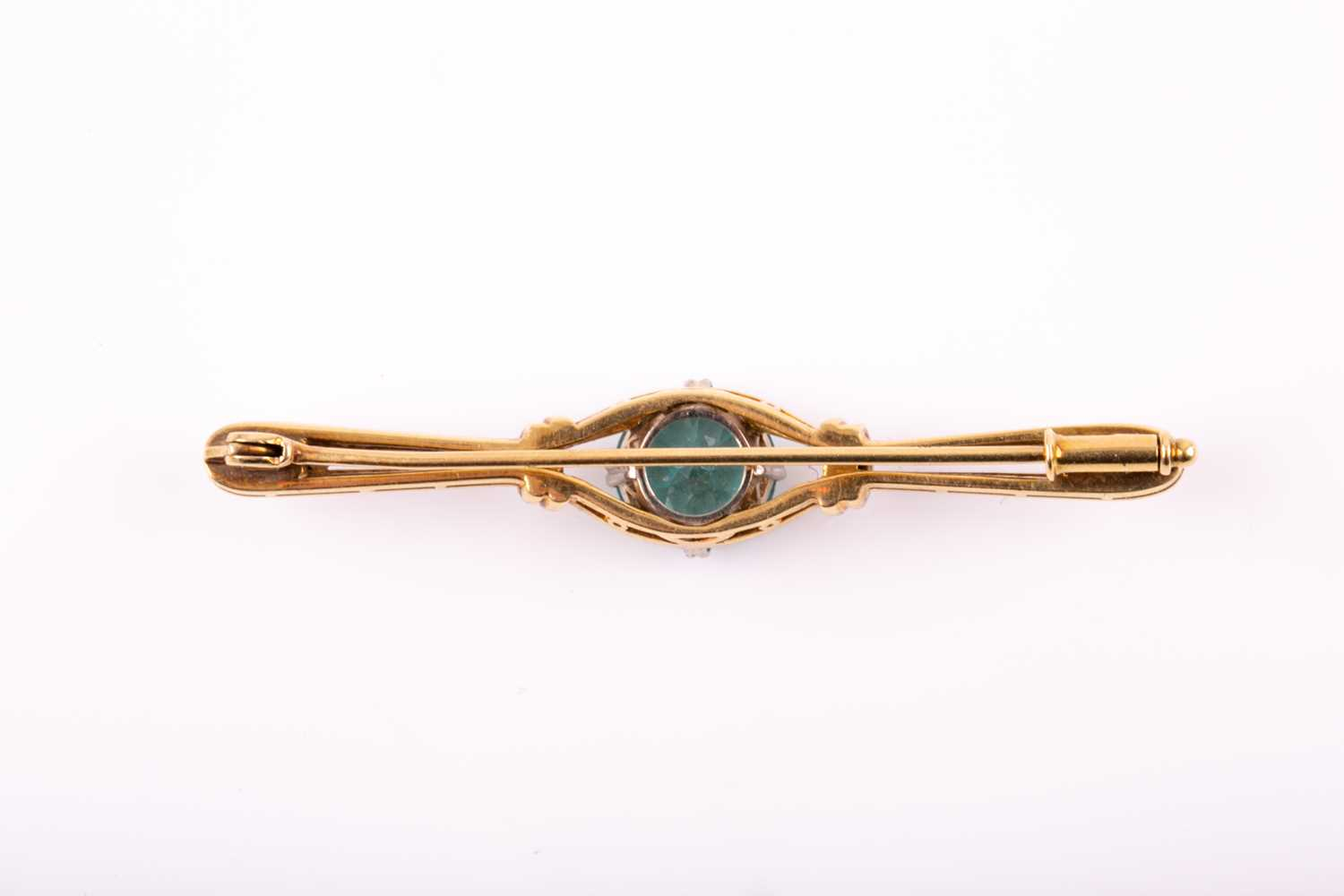 A white and yellow gold and blue zircon brooch, set with a mixed round-cut zircon measuring - Image 3 of 4