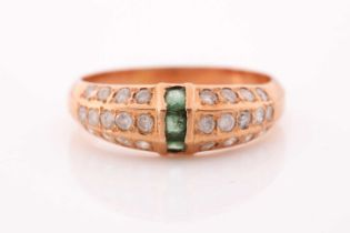 A yellow metal, emerald, and moissonite ring, set with three calibre-cut emeralds and pave-set