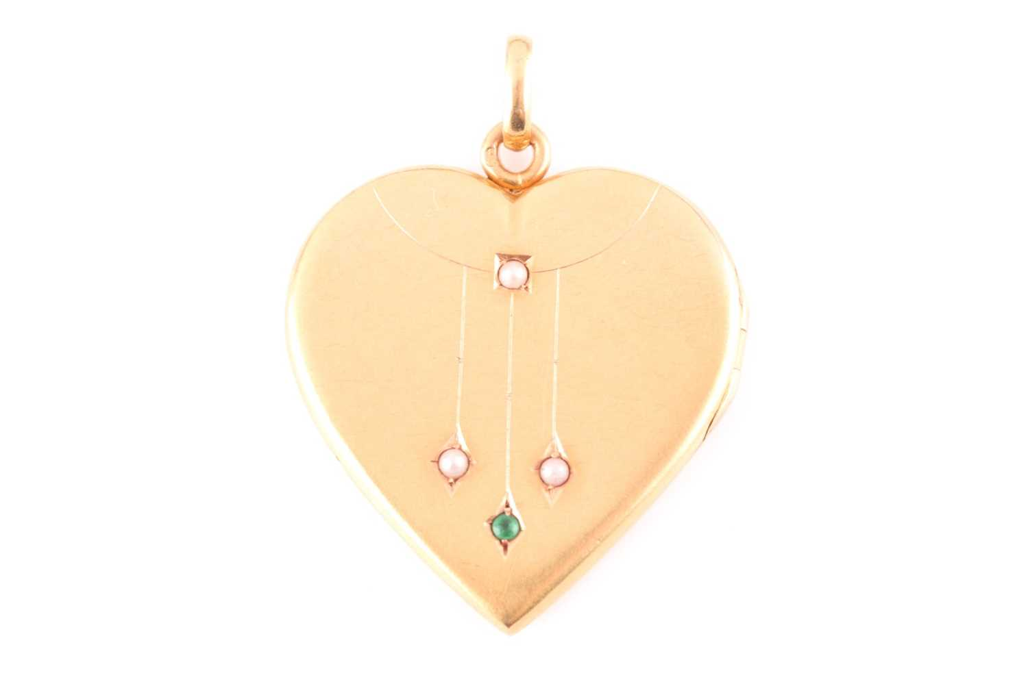 An early 20th century yellow metal heart-shaped locket pendant, the hinged front inset with small
