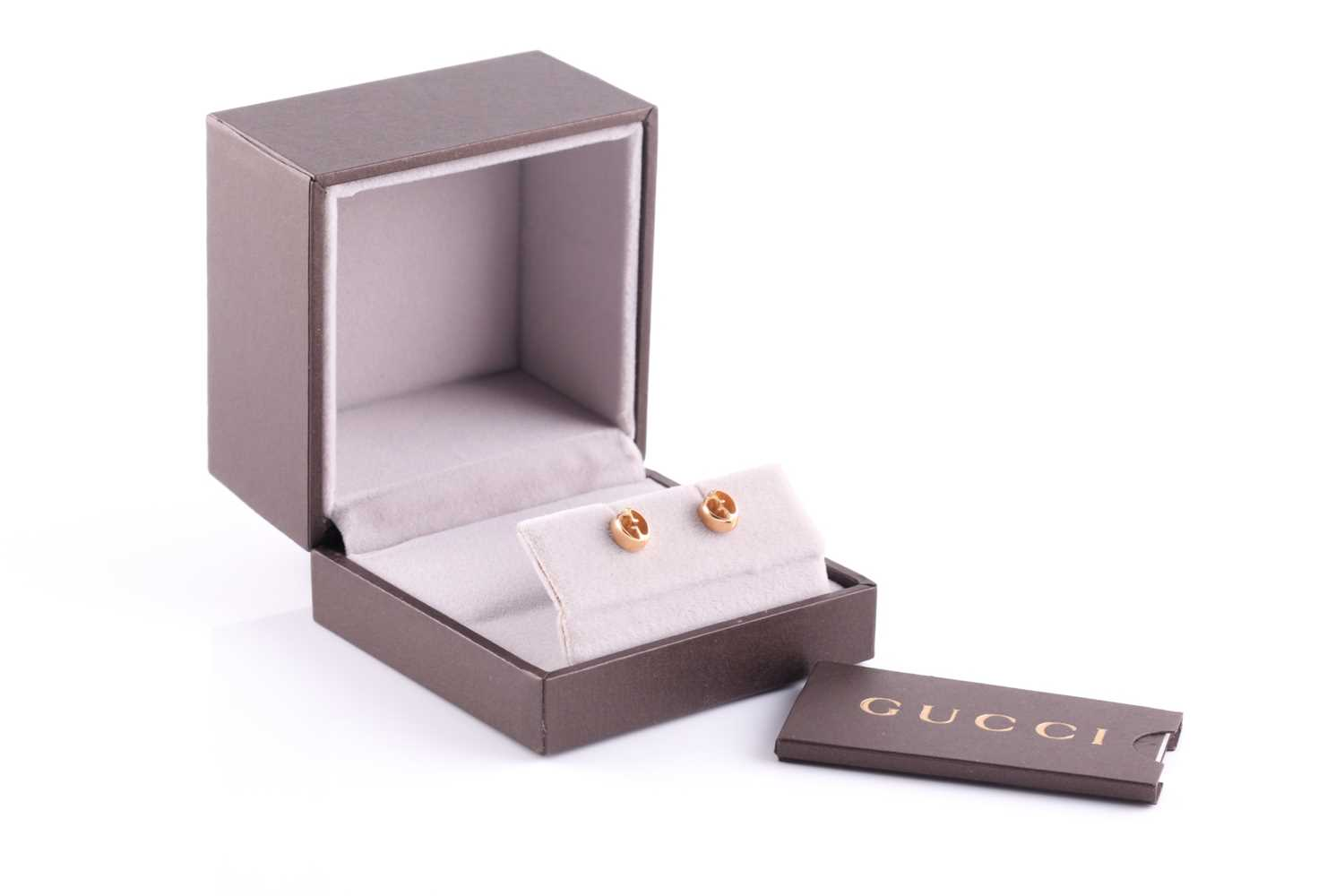 Gucci. A pair of 18ct yellow gold stud earrings of double G design, in original box and outer box.
