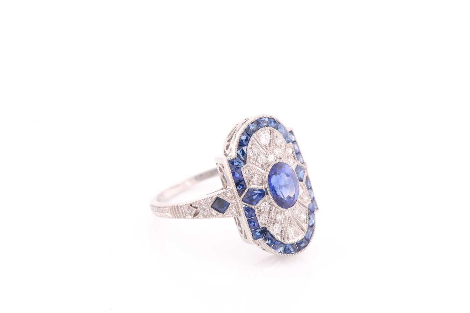 A platinum, diamond, and sapphire plaque ring, in the Art Deco style, centred with a mixed oval- - Image 3 of 4