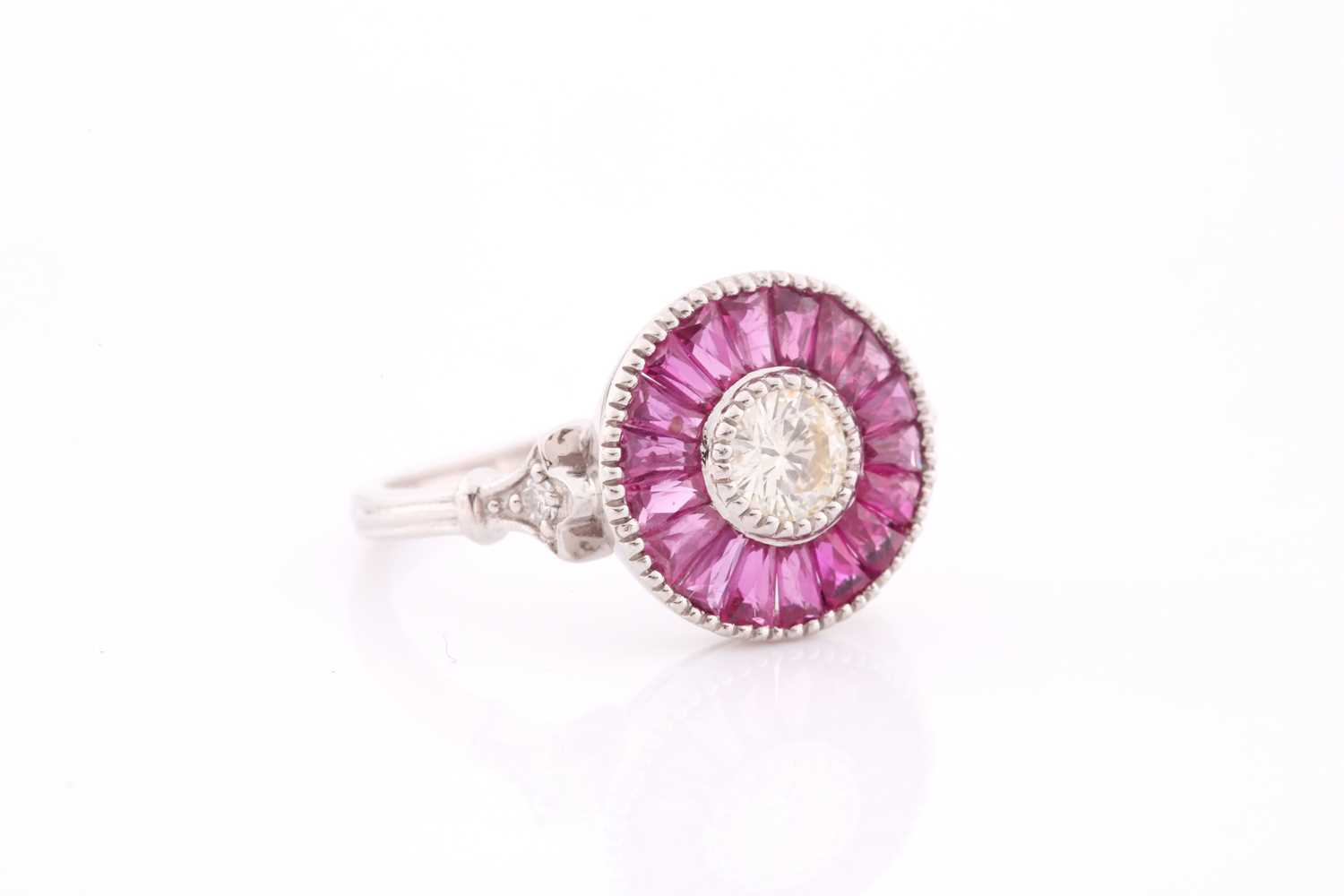 A diamond and ruby target ring, in the Art Deco style, centred with a round brilliant-cut diamond, - Image 2 of 4