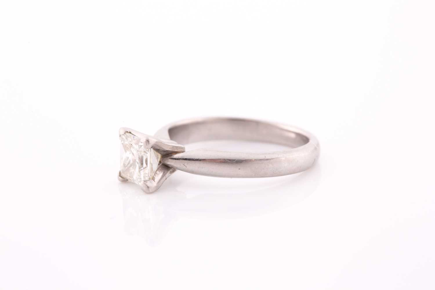 A platinum and diamond ring, set with a princess-cut diamond of approximately 0.80 carats, - Image 3 of 4