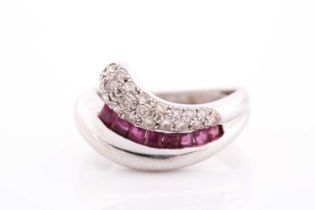 An 18ct white gold, diamond, and ruby ring, of swept design, pave-set with round brilliant-cut