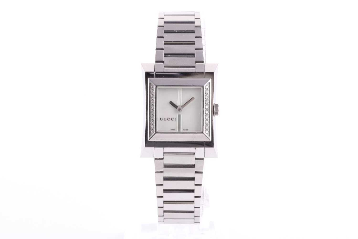 A ladies stainless steel watch by Gucci, with mother-of-pearl square dial, small diamonds set to - Image 9 of 10